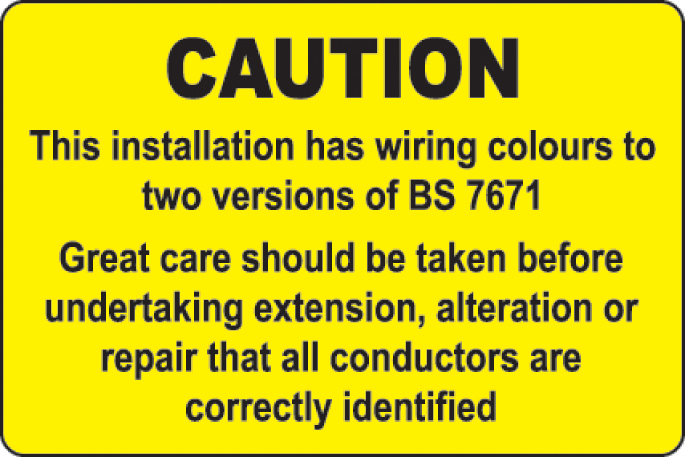 two versions of bs 7671 warning label roll of 100 75x50mm
