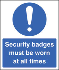 Security badges must be worn all times sign