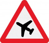 Low flying aircraft ahead road sign 558
